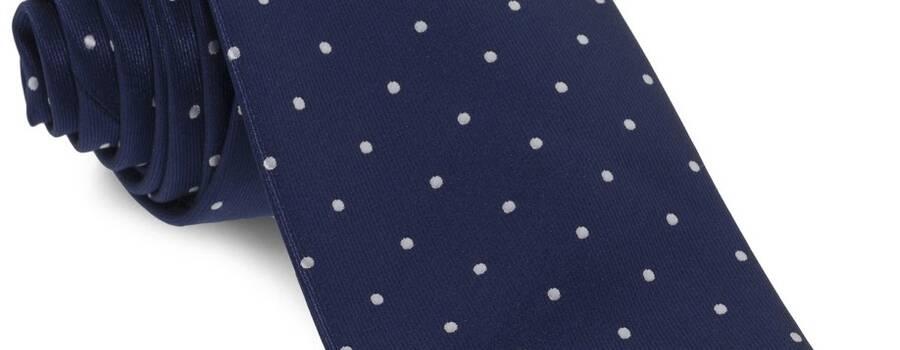 Corbata azul marino topos blancos