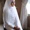 Turquía: Los vestidos blancos coinciden con la tradición occidental, pero las novias llevan esta típica pieza que tapa cuello y cabello.