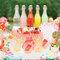 Mesa de postres decorada con colores cítricos - Foto KT Merry Photography
