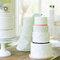 Pasteles de boda con decoraciones de abanicos y líneas