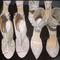 Scarpe e sandali in pizzo della collezione  di Monique Lhuillier Spring 2014. Foto via The Dress