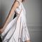 Vestido de fiesta 2014 en color blanco con detalles de transparencias y acabado asimétrico