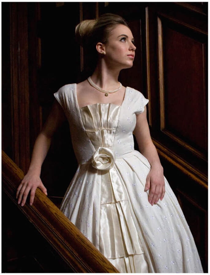 Grace: Pleated wedding gown made of organic cotton jersey with floral embroidery, a center inset of cascading hemp silk pleats, a hemp-silk rose detail at the waistline and a chapel-length train. By M.L. Marsh for Poetic Justice