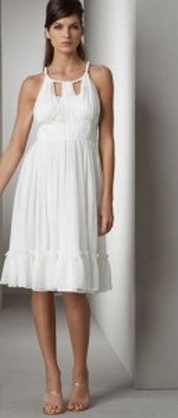 Wedding dress by Alberto Makali
