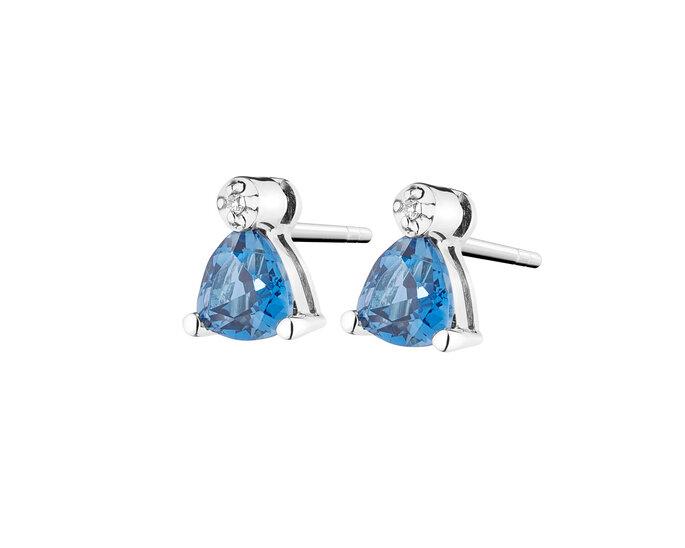 Kolczyki z białego złota z diamentami i topazami (London Blue); źródło: Apart
