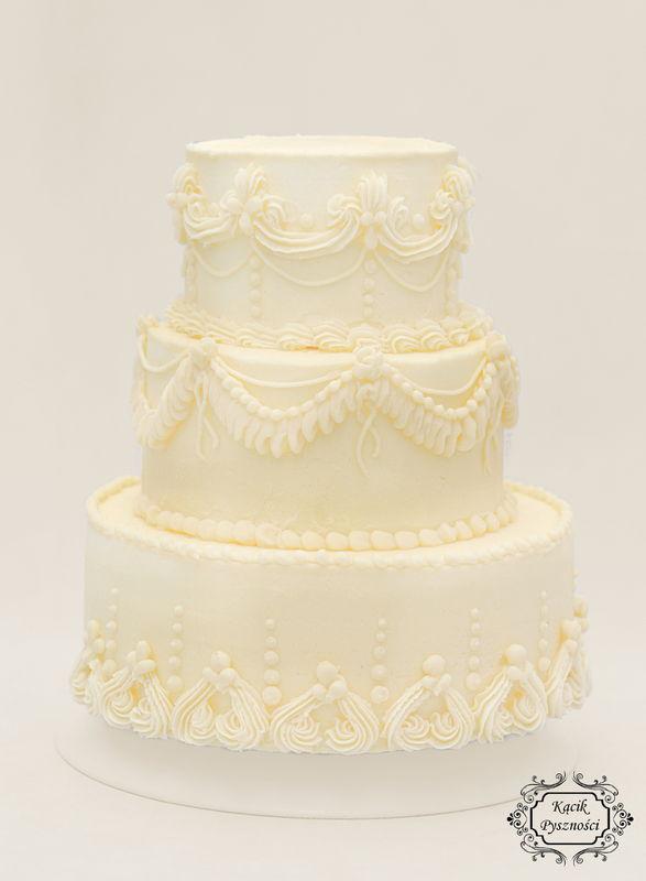 Tort n a królewskie wesele. Bogato zdobiony, elegancki, z klasą.   Doda uroku nie tylko tej wyjątkowej uroczystości ale również będzie do nas powracał w miłych wspomnieniach.