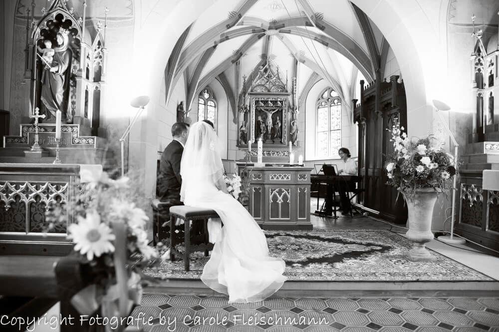 Beispiel:Während der Zeremonie in der Kirche,Foto:Carole Fleischmann Fotografie