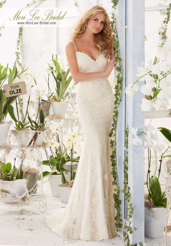 """Dress Style OLZE Diamante Beaded Straps On a Soft Net Gown With Delicately Beaded Alencon Lace Appliques And Edging Onto The Sheer Train  Available in Three Lengths: 55"""", 58"""", 61"""". Colors available: White, Ivory, Ivory/Champagne, Ivory/Blush."""