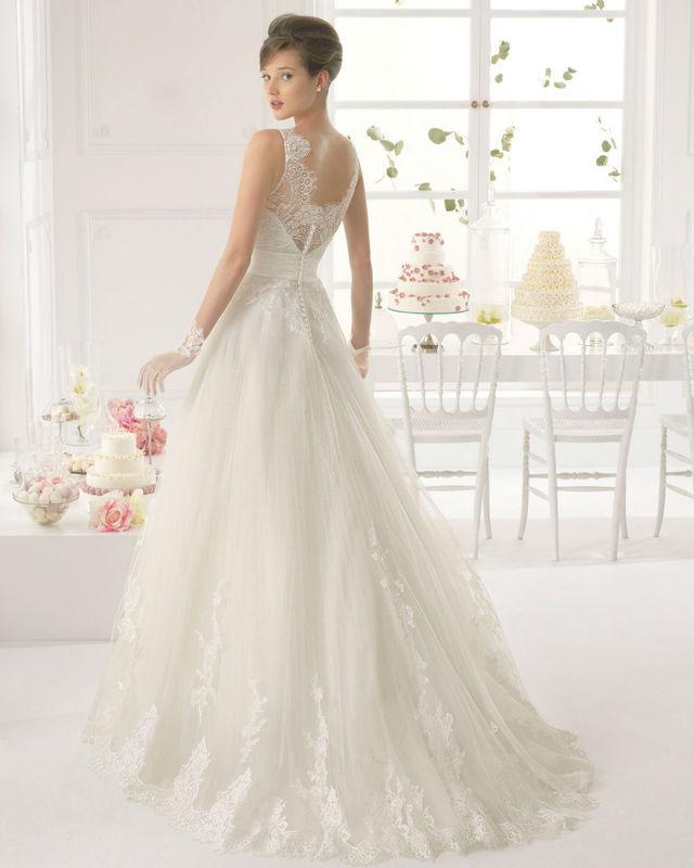 Robe de mariée Aire par Rosa Clará par votre boutique Confidence Mariage