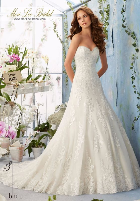 """Dress Style AIZI Embroidered Lace Appliques Decorated The Net Gown With Scalloped Hemline Over Soft Satin  Available in Three Lengths: 55"""", 58"""", 61"""". Colors available: White, Ivory, Ivory/Coco."""