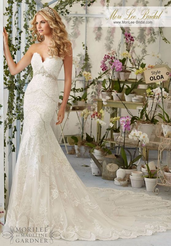 """Dress Style OLOA Embroidered Appliques And Scalloped Edging On The Net Gown With Sheer Train And Crystal Moonstone Beading  Available in Three Lengths: 55"""", 58"""", 61"""". Colors available: White/Silver, Ivory/Silver, Ivory/Light Gold/Silver, Ivory/Blush/Silver."""