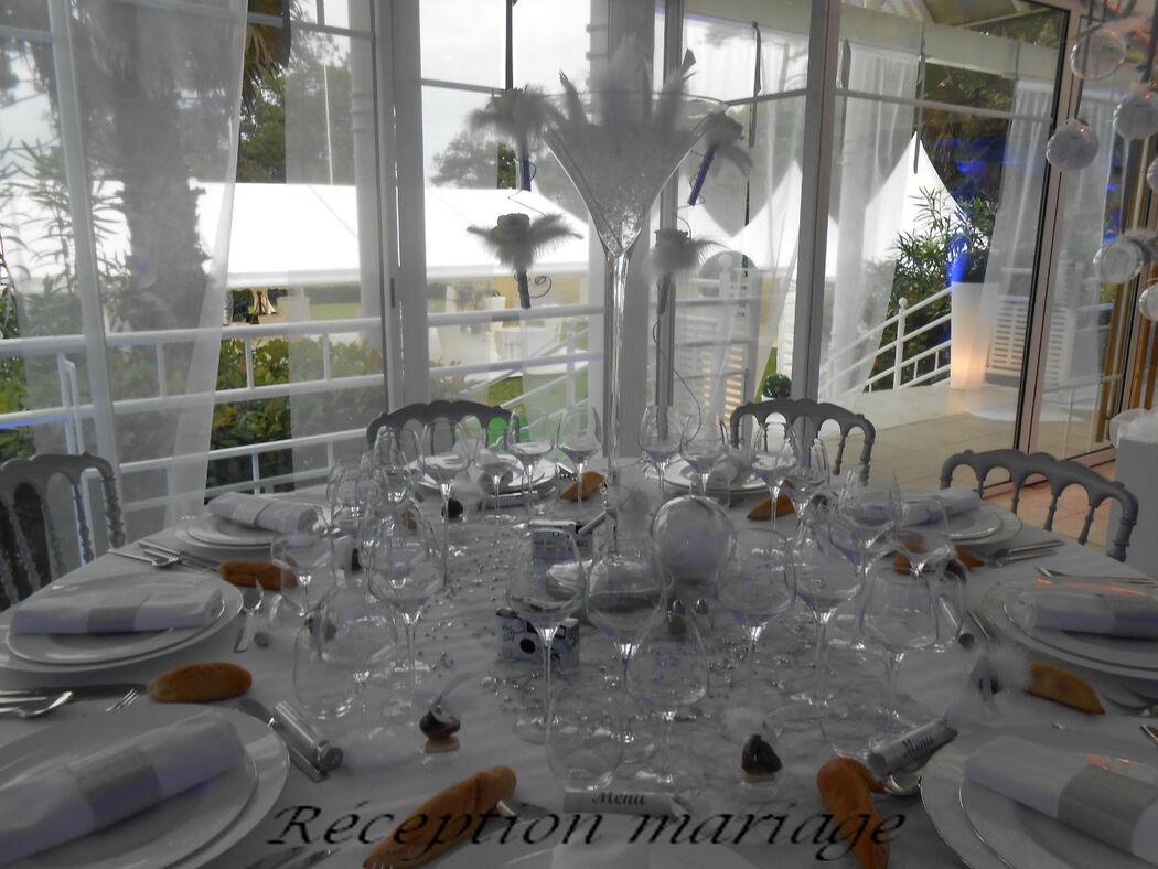 Salle du Tir au Vol à Arcachon: élégance en blanc et gris, jeu de transparences et plumes.