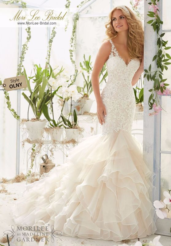 """Dress Style OLNY Vintage Pearl And Crystal Beading On Alencon Lace Appliques Over Chantilly Lace Onto An Organza And Tulle Flounced Mermaid Gown  Available in Three Lengths: 55"""", 58"""", 61"""". Colors available: White, Ivory, Ivory/Light Gold, Ivory/Blush."""