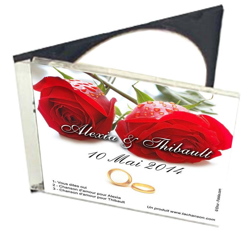 Le cd avec les trois chansons personnalisées avec les prénoms des mariés et la date du mariage