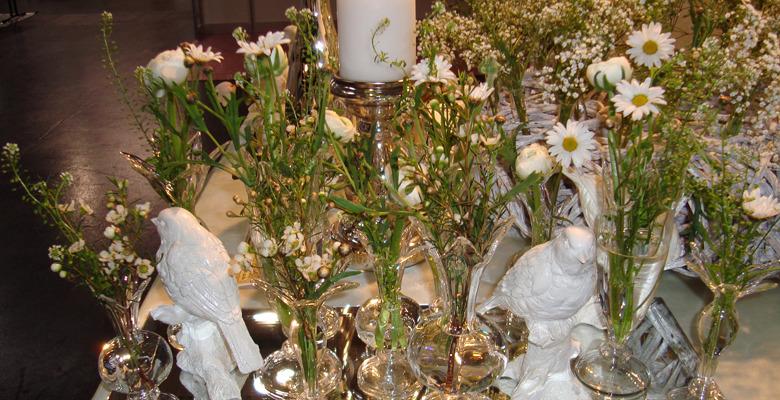 Beispiel: Dekorativer Tischschmuck, Foto: Blumen Gran.