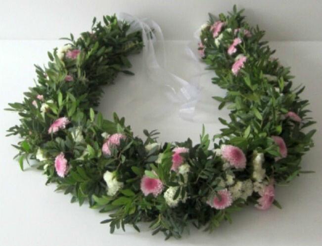 Beispiel: Blumenkranz für das Bankett, Foto: Blumen Wunder.
