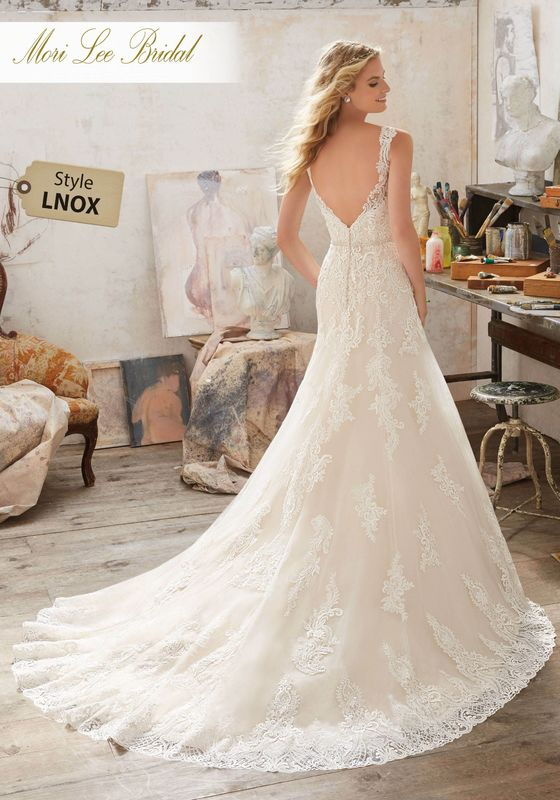 Dress style LNOX Mariana Wedding Dress Available in Three Lengths: 55″, 58″, 61″. Colors Available: White, Ivory, Ivory/Champagne. Shown in Ivory/Champagne.