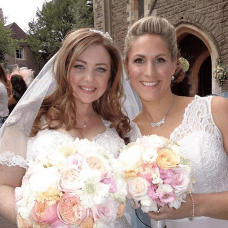 Bride and her Bridesmaids just about to go into the Church in Wiltshire. Hair & Makeup by kkmakeupartist.co.uk