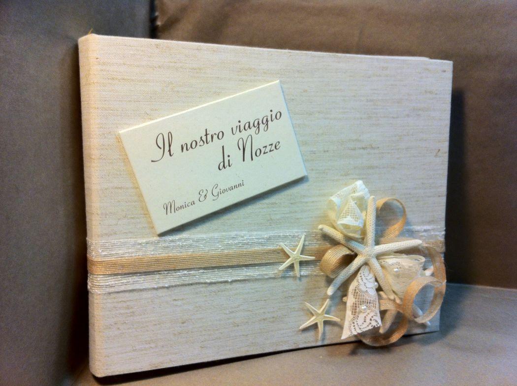 Guest book tela e conchiglie per matrimonio a tema mare
