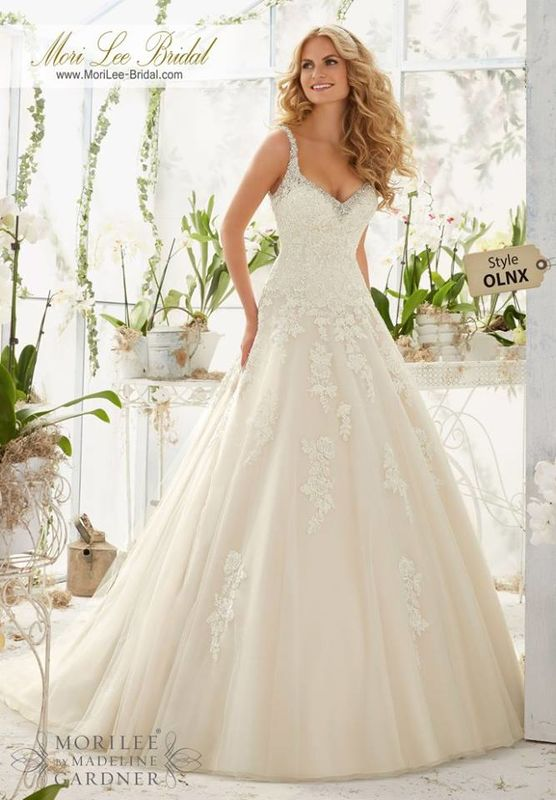 Wedding Dress OLNX  Crystal Beaded Edging Meets the Alencon Lace Appliques on the Tulle Ball Gown  Colors available: White/Silver, Ivory/Silver, Light Gold/Silver.