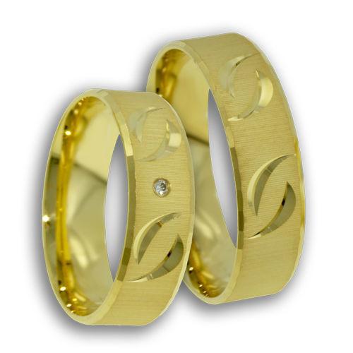 Beispiel: Trauringe - Gelbgold mit Diamant, Foto: Designer Diamonds München.