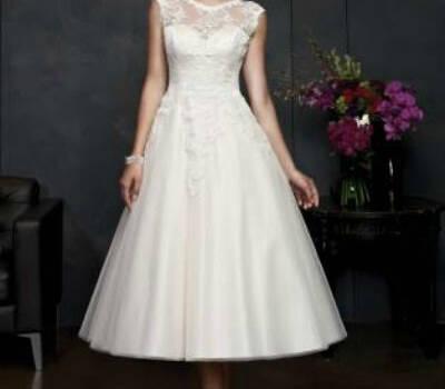 Beispiel: Brautkleid, Foto: Happy Brautmoden.