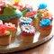 Decoración con dulces para la mesa de postres