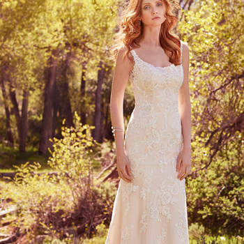 "Striking lace appliqués cascade from the embellished straps to delicate hem in this romantic sheath, accented with beading, Swarovski crystals, and shimmering sequins. Featuring a classic scoop neckline and illusion back accented with lace appliqués. Finished with crystal buttons over zipper closure.  <a href=""https://www.maggiesottero.com/maggie-sottero/phoebe/10133?utm_source=mywedding.com&amp;utm_campaign=spring17&amp;utm_medium=gallery"" target=""_blank"">Maggie Sottero</a>"