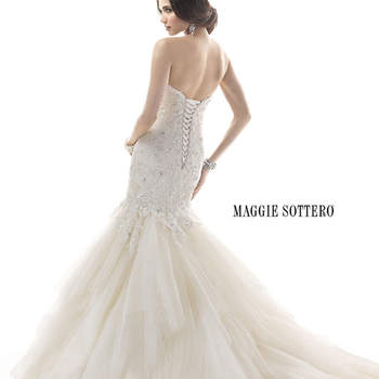 "Tiers of tulle create glamour and drama in this fit and flare gown. Swarovski crystals adorn the embroidered lace over tulle bodice before erupting into a voluminous skirt. Finished with corset or zipper over inner corset closure.  <a href=""http://www.maggiesottero.com/dress.aspx?style=4MC832LU"" target=""_blank"">Maggie Sottero Platinum 2015</a>"