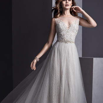 Flowing tulle over romantic lace combine to create this sheath dress, with stunning illusion neckline and back, adorned with lace appliqués. Swarovski crystal belt accents the waist. Finished with crystal button over invisible zipper closure. <img height='0' width='0' alt='' src='http://ads.zankyou.com/mn8v' />