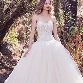 This enchanting ballgown features a strapless bodice of beaded lace appliqués and Swarovski crystal embellishments. A soft sweetheart neckline and voluminous layers of tulle evoke fairytale romance. Finished with covered buttons over zipper and inner corset closure.