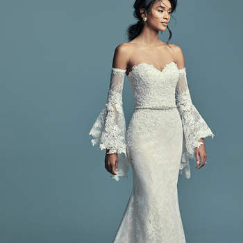 "<a href=""https://www.maggiesottero.com/maggie-sottero/tenille/11509"">Maggie Sottero</a>  Chic lace motifs dance over allover lace in this boho fit-and-flare wedding dress, accenting the bodice and breathtaking hem. Complete with strapless sweetheart neckline. Finished with zipper over inner corset closure, with covered buttons trailing from back to hem. Illusion lace poet sleeves sold separately. Detachable beaded belt accented in Swarovski crystals sold separately. Detachable illusion lace cap-sleeves can be worn on or off the shoulder, sold separately."