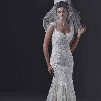 The definition of pure romance is found in this fit and flare wedding dress, featuring lace appliqués, embroidered with pearls and Swarovski crystals, and accented with a sweetheart neckline and feminine cap-sleeves. A double keyhole back provides an extra dose of drama. Finished with crystal buttons over zipper closure. <img height='0' width='0' alt='' src='http://ads.zankyou.com/mn8v' />
