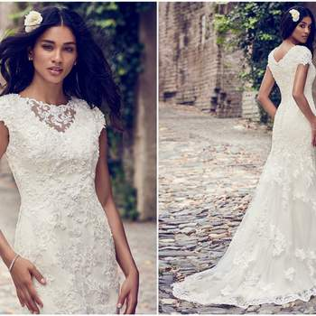 "Beaded lace motifs cascade over tulle in this classic fit-and-flare wedding dress, accenting the illusion bateau neckline and illusion-trimmed cap-sleeves. Lined with shapewear for a figure-flattering fit. Finished with covered buttons over zipper closure.   <a href=""https://www.maggiesottero.com/maggie-sottero/stacey/11193?utm_source=zankyou&amp;utm_medium=gowngallery"" target=""_blank"">Maggie Sottero</a>"
