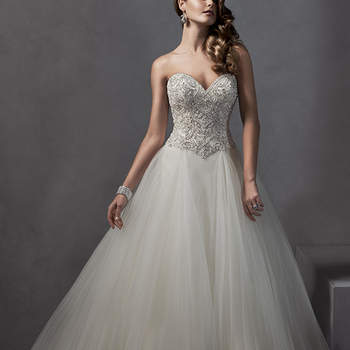 Decadent Swarovski crystals and pearls adorn the bodice of this romantic ballgown, complete with voluminous tulle skirt and dramatic sweetheart neckline. Finished with crystal button over zipper and inner corset closure. <img height='0' width='0' alt='' src='http://ads.zankyou.com/mn8v' />