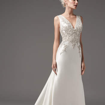 "This chic and sexy Yaron Mikado sheath features exquisite bead and Swarovski crystal embellishments along the bodice. Featuring a V-neckline and square back with beaded lace illusion detail atop a glamorous tunnel train. Finished with pearl buttons and zipper closure.  <a href=""https://www.maggiesottero.com/sottero-and-midgley/clayton/10214?utm_source=mywedding.com&utm_campaign=spring17&utm_medium=gallery"" target=""_blank"">Sottero and Midgley</a>"