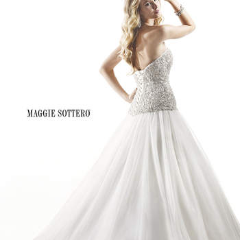 "Romance and timeless elegance are found in this stunning ballgown. Exquisite Swarovski crystal beading accents a drop waist before erupting into a voluminous tulle skirt. Finished with corset or zipper over inner corset back closure.  <a href=""http://www.maggiesottero.com/dress.aspx?style=4MT852LU"" target=""_blank"">Maggie Sottero Platinum 2015</a>"
