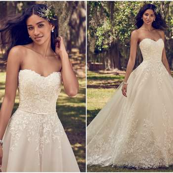 "Lace motifs cascade over tulle in this ballgown wedding dress, featuring a strapless scoop neckline and belt with bow detail. Finished with covered buttons over zipper and inner corset closure.  <a href=""https://www.maggiesottero.com/maggie-sottero/viola/11199?utm_source=zankyou&amp;utm_medium=gowngallery"" target=""_blank"">Maggie Sottero</a>"