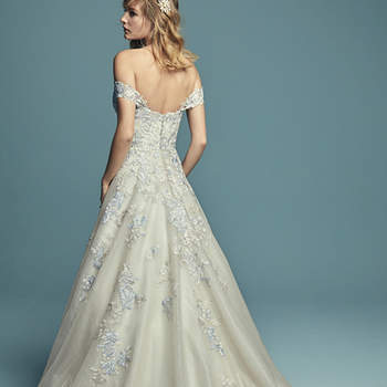 "<a href=""https://www.maggiesottero.com/maggie-sottero/maine/11494"">Maggie Sottero</a>  Gorgeous colored lace motifs dance over the bodice of this wedding dress, adding dimension to the A-line skirt comprised of textured, shimmering tulle. Complete with strapless sweetheart neckline and attached beaded belt accented in Swarovski crystals. Finished with crystal buttons over zipper and inner elastic closure. Illusion lace cap-sleeves can be worn on or off the shoulder, sold separately."
