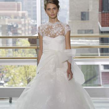 Vestido de novia corte princesa, con encaje chantilly y cinturón en moño al frente, falda con capas en tul