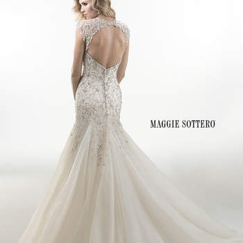 "Lavish Swarovski crystals adorn this heavily beaded tulle A-line with voluminous skirt. Finished with crystal buttons and zipper over inner corset back closure. Available with illusion, keyhole coverlet.  <a href=""http://www.maggiesottero.com/dress.aspx?style=4MS977KC"" target=""_blank"">Maggie Sottero Platinum 2015</a>"