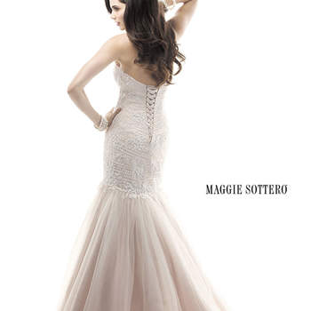 "Delicate sequin embellished embroidery on tulle drape the bodice in this form fitting fit and flare gown. A sweetheart neckline dances across the décolletage, whispering femininity. Finished with corset back closure.  <a href=""http://www.maggiesottero.com/dress.aspx?style=4MT892"" target=""_blank"">Maggie Sottero Platinum 2015</a>"