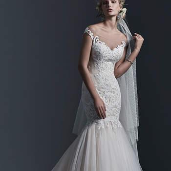 """Wunderschön geformter Herzausschnitt vorne und hinten: Ein künstlerisches und beeindruckendes Brautkleid, das in einem atemberaubenden Tüll-Rock endet und mit einem Reißverschluss geschlossen wird.  <a href=""""http://www.sotteroandmidgley.com/dress.aspx?style=5SC640"""" target=""""_blank"""">Sottero &amp; Midgley</a>"""