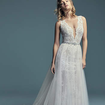 "<a href=""https://www.maggiesottero.com/maggie-sottero/hailey-marie/11269"">Maggie Sottero</a>  Lace motifs cascade over crosshatch and tulle in this unique fit-and-flare wedding gown, completing the bodice and illusion skirt. Featuring an illusion plunging V-neckline, straps, and square back, and lined with inner bodysuit for a flattering fit. Finished with covered buttons over zipper closure. Detachable tulle overskirt accented with an attached beaded belt sold separately."
