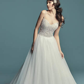 "<a href=""https://www.maggiesottero.com/maggie-sottero/lucca/11281"">Maggie Sottero</a>  This princess wedding dress features a bodice of beaded embroidery, accented in Swarovski crystals. Ballgown skirt comprised of tulle and trimmed in horsehair. Beaded straps complete the soft V-neckline and scoop back. Finished with pearl buttons over zipper closure."