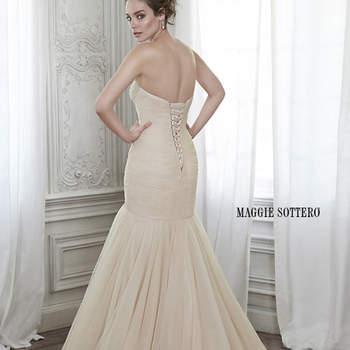 """Un diseño impresionante y un vestido de novia de tul plisado con falda voluminosa, que se completa con un escote corazón romántico y se cierra a modo corsé. Está disponible con la opción de cinta floral y motivos florales adornados a mano.   <a href=""""http://www.maggiesottero.com/dress.aspx?style=5MZ134"""" target=""""_blank"""">Maggie Sottero Spring 2015</a>"""