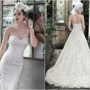 """<a href=""""https://www.maggiesottero.com/maggie-sottero/dallasandra/9278"""" target=""""_blank"""">Maggie Sottero</a>  Elegance and romance combine to create this dreamy ball gown. Exquisite lace, accented with pearl embellishments, adorns a fitted bodice before flaring into a voluminous tulle skirt, edged in delicate lace. Complete with sweetheart neckline, optional lace cap-sleeves and corset closure."""