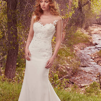 "This gorgeous sheath features a bodice embellished with lace appliqués and delicate pearls and Swarovski crystals, flowing into a simple Sylvie crepe skirt. An illusion sweetheart neckline complements an illusion keyhole-back accented in lace appliqués. Finished with covered buttons over zipper closure.  <a href=""https://www.maggiesottero.com/maggie-sottero/dion/10097?utm_source=mywedding.com&amp;utm_campaign=spring17&amp;utm_medium=gallery"" target=""_blank"">Maggie Sottero</a>"