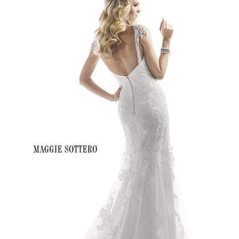 "Dazzling Swarovski crystals draped over the shoulders create a hint of glamour on this otherwise demure sheath gown of corded lace over Valentina Satin. Finished with zipper over inner elastic closure.  <a href=""http://www.maggiesottero.com/dress.aspx?style=4MS854"" target=""_blank"">Maggie Sottero Platinum 2015</a>"