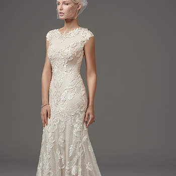 "This unique and glamorous fit-and-flare features laser-cut lace over textured netting and Viva jersey lining with a jewel neckline and modest cap-sleeves trimmed with lace appliqués. Finished with zipper closure.  <a href=""https://www.maggiesottero.com/sottero-and-midgley/suzanne-rose/10253?utm_source=mywedding.com&utm_campaign=spring17&utm_medium=gallery"" target=""_blank"">Sottero and Midgley</a>"